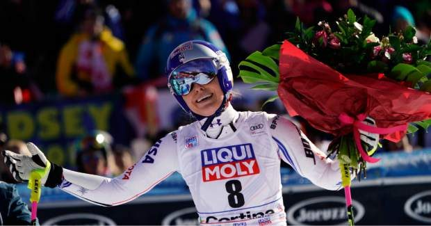 Vonn holds a bunch of flowers after completing an alpine ski women's World Cup super-G event in Cortina D'Ampezzo, Italy on Jan. 20.