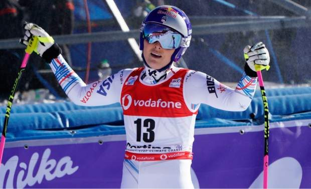 Vonn opens her arms after completing in an alpine ski women's World Cup downhill event in Cortina D'Ampezzo, Italy earlier this season.