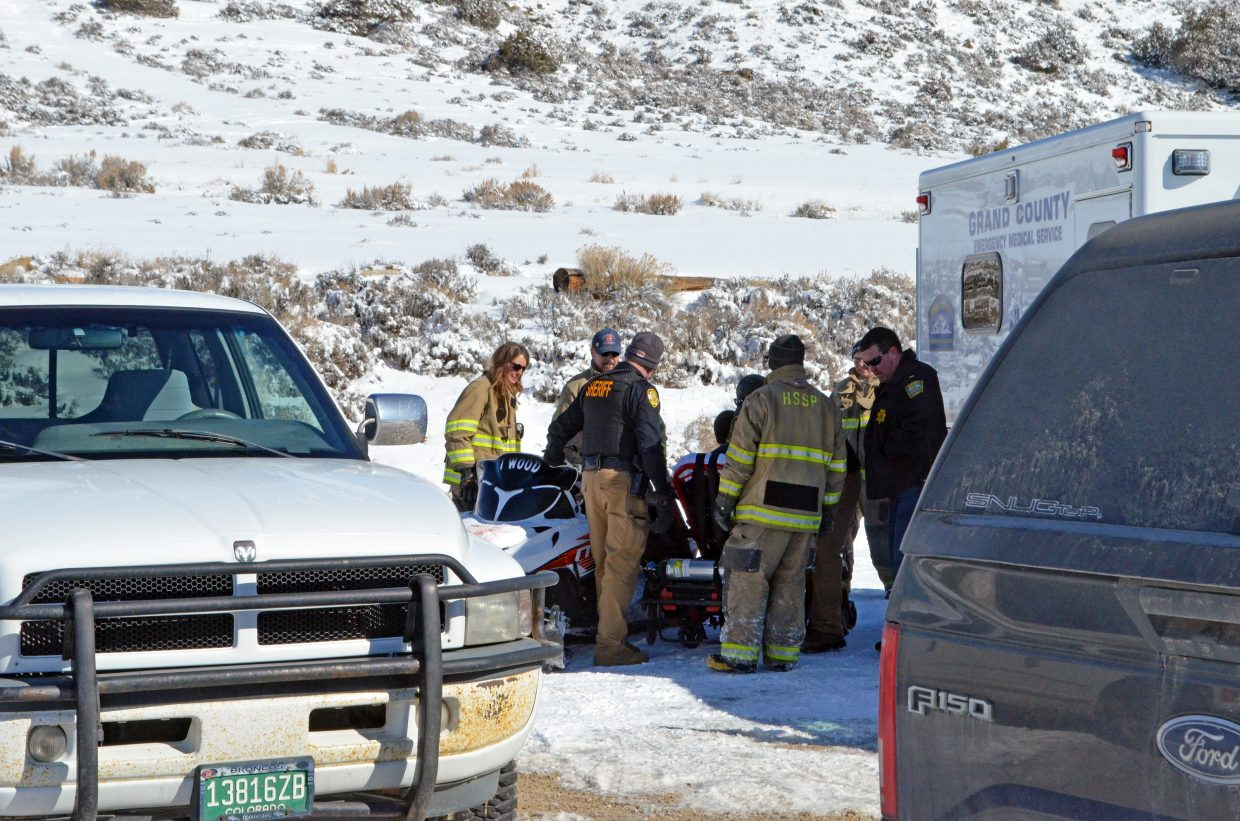 Emergency crews load the man rescued from the ice into an ambulance.
