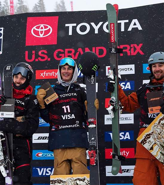 Birk Irving (center) stands on the podium aftering taking first place in the US Grand Prix event held at Mammoth Mountain over the weekend.