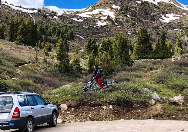A snowmobiler picks his way down fragile, snow-free terrain to the Upper Lost Man Trailhead on July 3. Snowmobiles are not allowed in the wilderness even if there was snow.