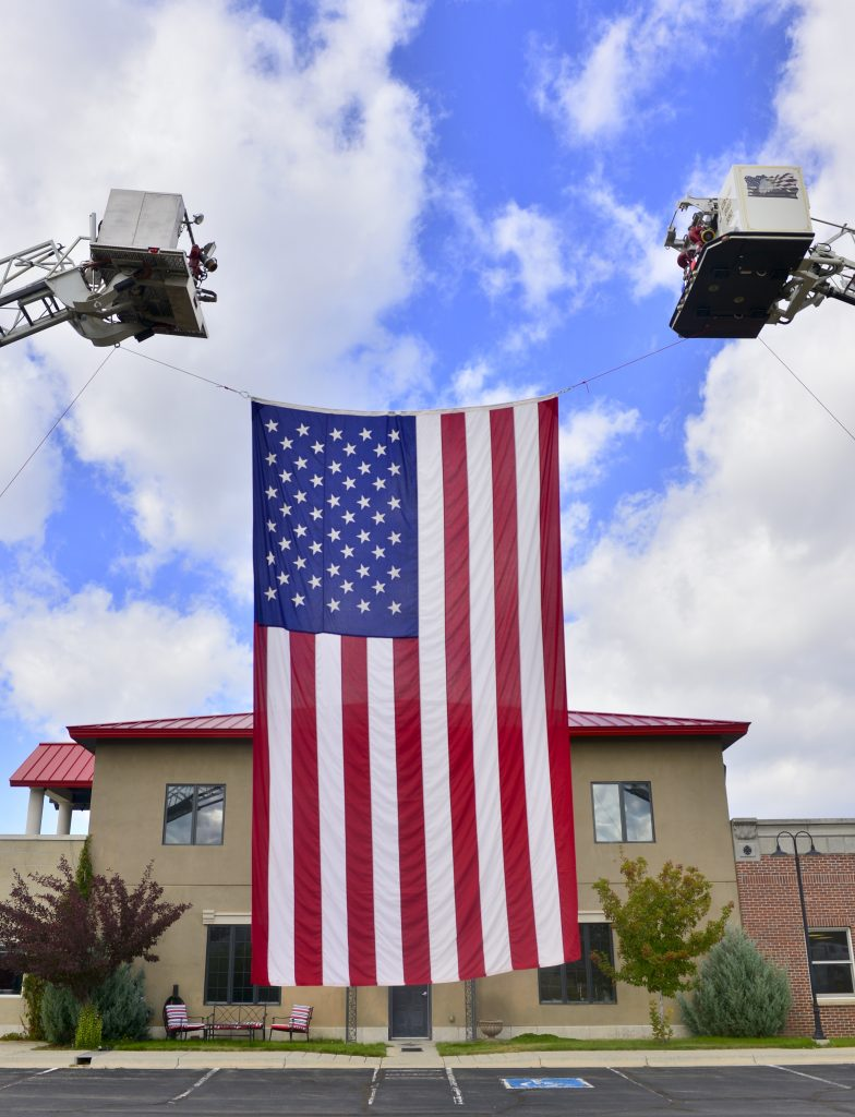 An American flag flies in front of the Grand Fire Protection District on Wednesday.