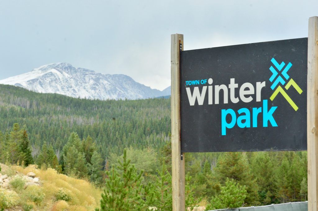 From the town of Winter Park, snow is visible on some of the nearby mountains on Friday. Many people in the area celebrated the recent snowfall that signifies the coming of winter.