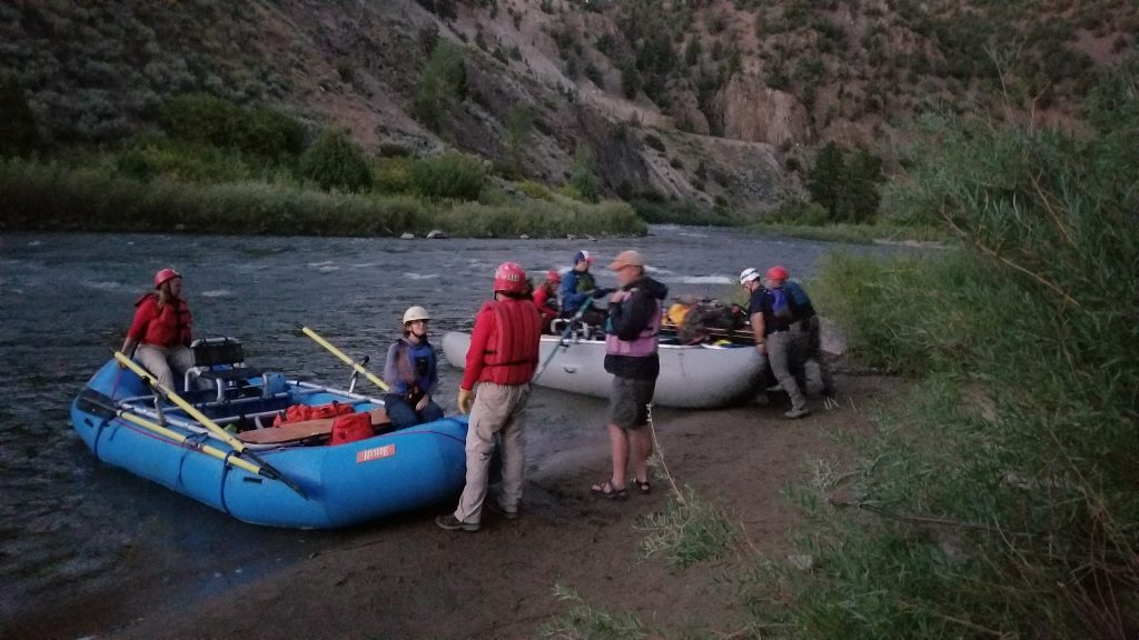 Grand County Search and Rescue team members launch boats on the Colorado River during a Saturday mission to rescue a young woman who had fallen in a ravine.