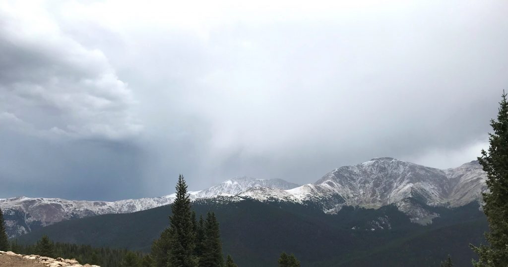 This photo taken at Winter Park Resort shows new snow coloring the nearby mountains along the Continental Divide on Friday.