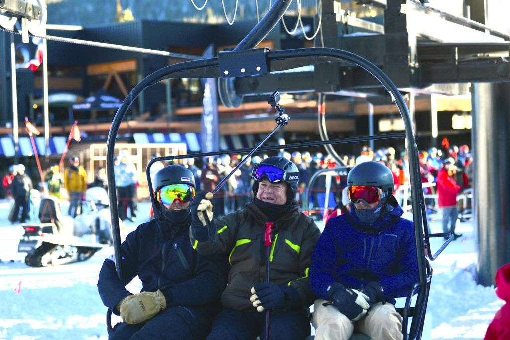 The three people on the first chair lift of the 2019-20 ski season at Winter Park Resort.