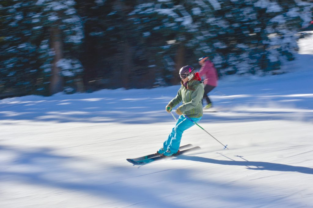 A skier takes one of the first runs of the season at Winter Park Resort when the mountain opened on Saturday.