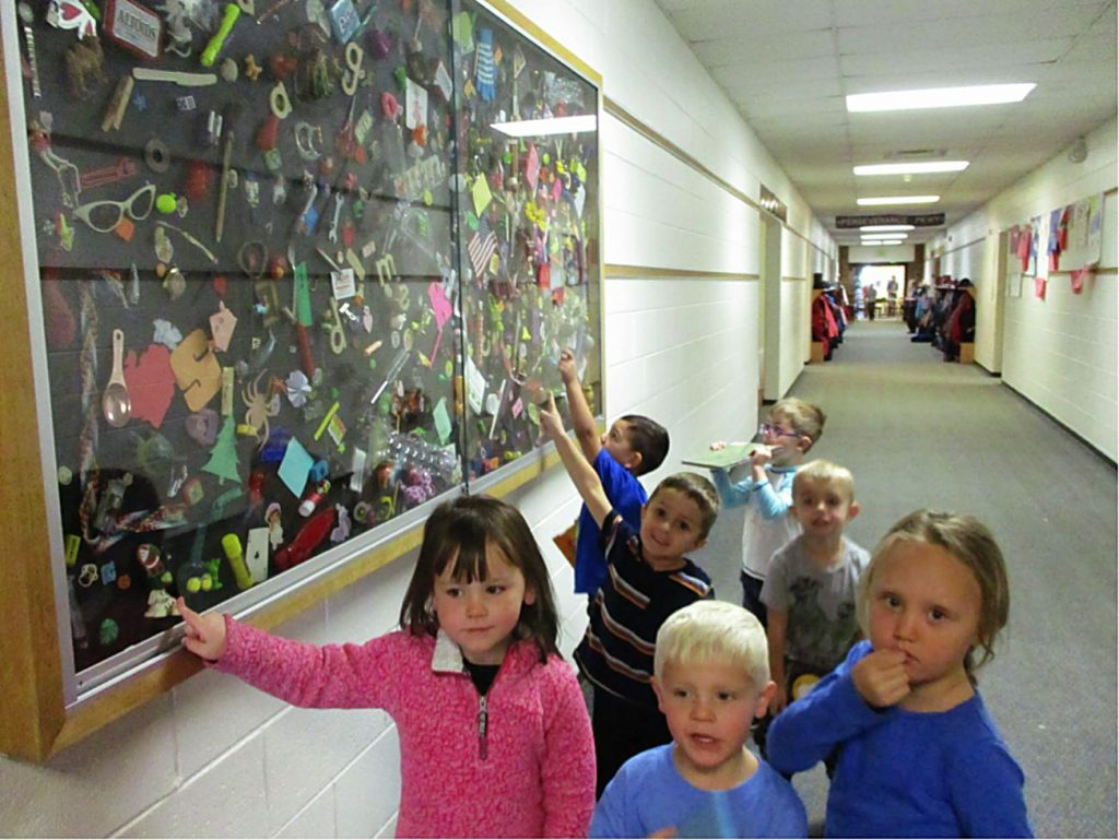 Interventionist Laura Hester and her team of creative students created a 7 by 4 foot I SPY display full of trinkets, pictures and recycled gadgets at Granby Elementary School.