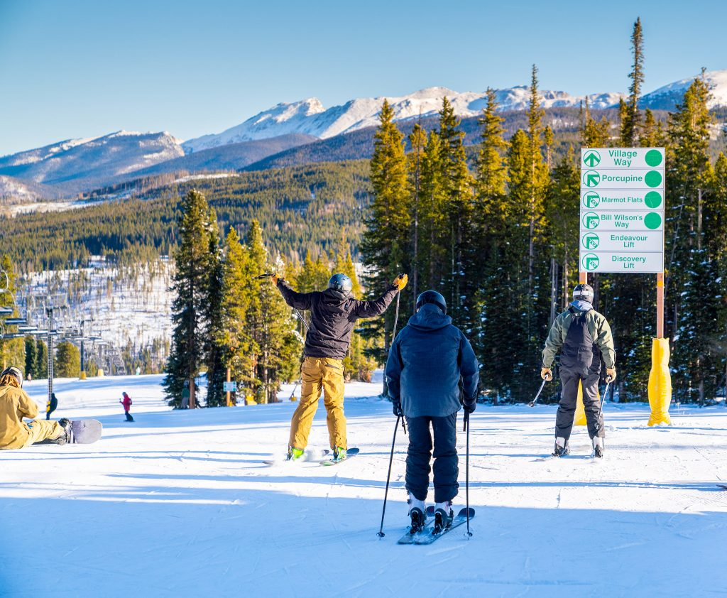 Skiers celebrate the beginning of their first run in Winter Park early Saturday morning.