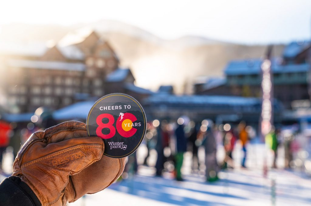 Winter Park employees handed out stickers commemorating the park's 80th season Saturday.