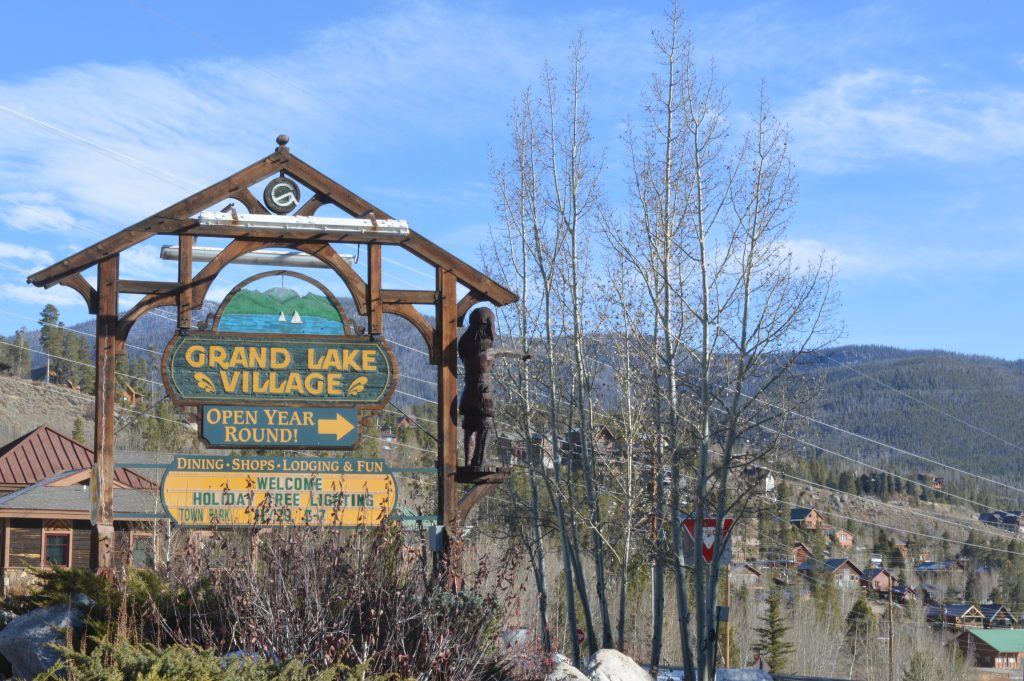 The sign outside Grand Lake lets visitors know that local businesses offer shopping and food throughout the winter and year.