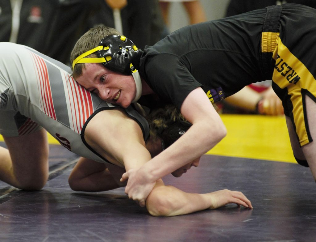 West Grand's Ben Biekert faces Cole Muhme of Steamboat Springs in the 106 pound championship match Saturday in Kremmling.