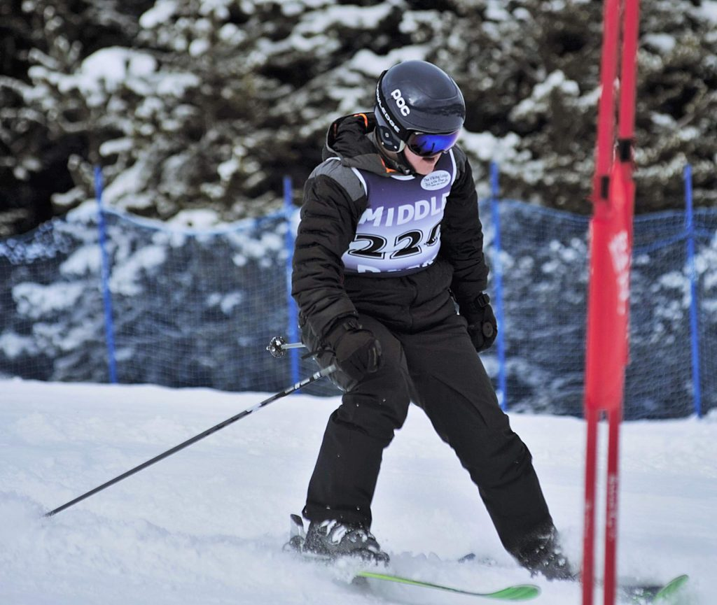 Middle Park alpine skier Sam Parker nears the finish line for the boys giant slalom event Friday at Winter Park Resort.