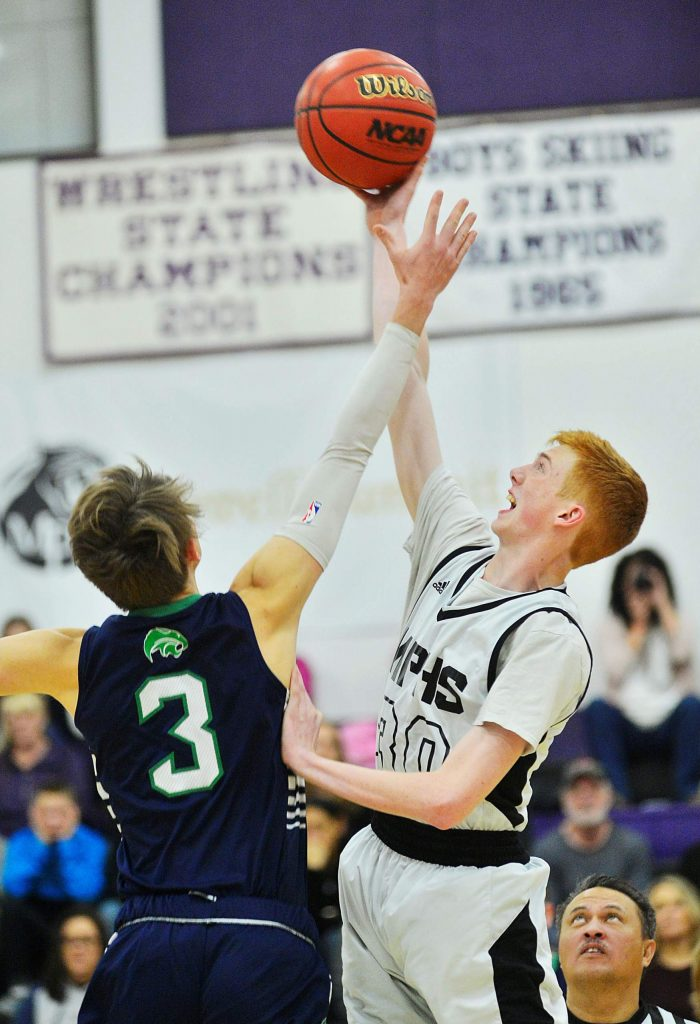Middle Park sophomore Seth Holestine wins the tipoff against The Academy during a boys basketball game Wednesday in Granby. The Panthers won 56-54.