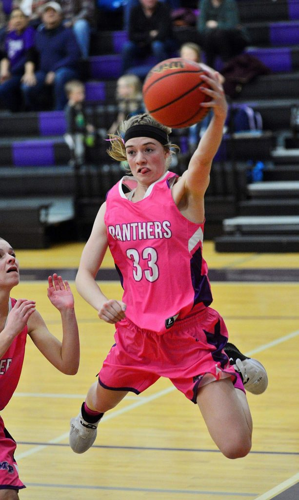 Middle Park junior Katie Trail tries to save a ball from going out of bounds as the Panthers faced The Academy on Wednesday in Granby.