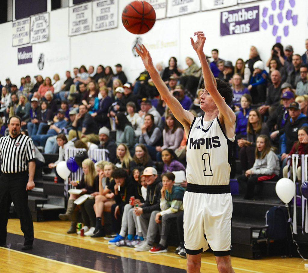 Panthers senior Jacob Smith knocks down a 3-pointer Tuesday vs. Bennett in the Class 3A district tournament. Middle Park won 77-51 at home.