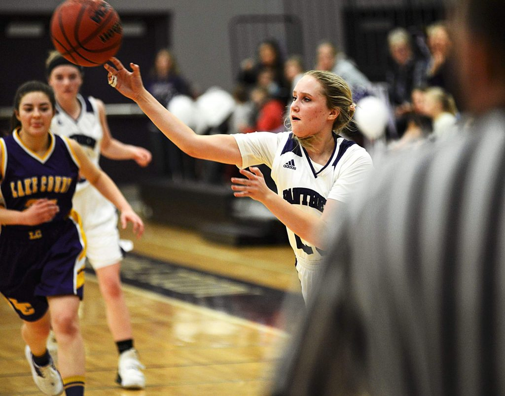 Middle Park's Dominyka Reventaite passes the ball past Lake County defenders during a Class 3A district tournament game on Tuesday in Granby. Middle Park won 55-23.