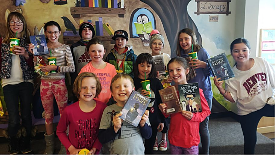 """The """"Reading Rhinos"""" book club poses for a photo after their final lunch meeting at the Fraser Valley Elementary School."""