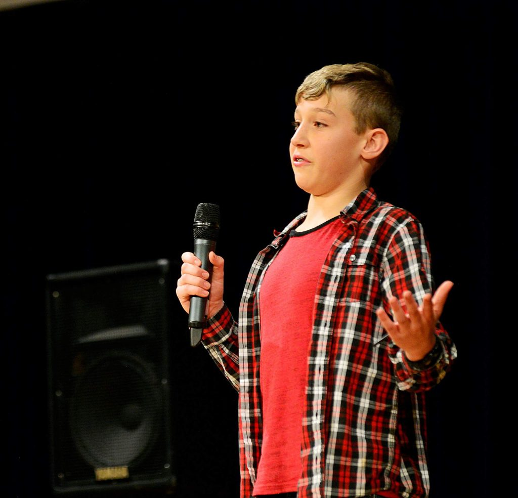 Eighth-grader Kai Edson cracks up the audience as he performs a stand up comedy act Wednesday at West Grand High School.