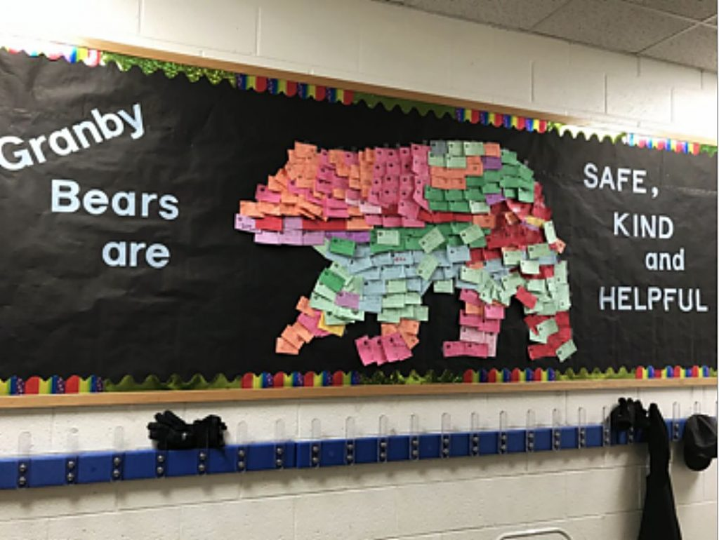 The entire Granby Bear on the bulletin board at Granby Elementary is made out of notes given to students for positive behavior.