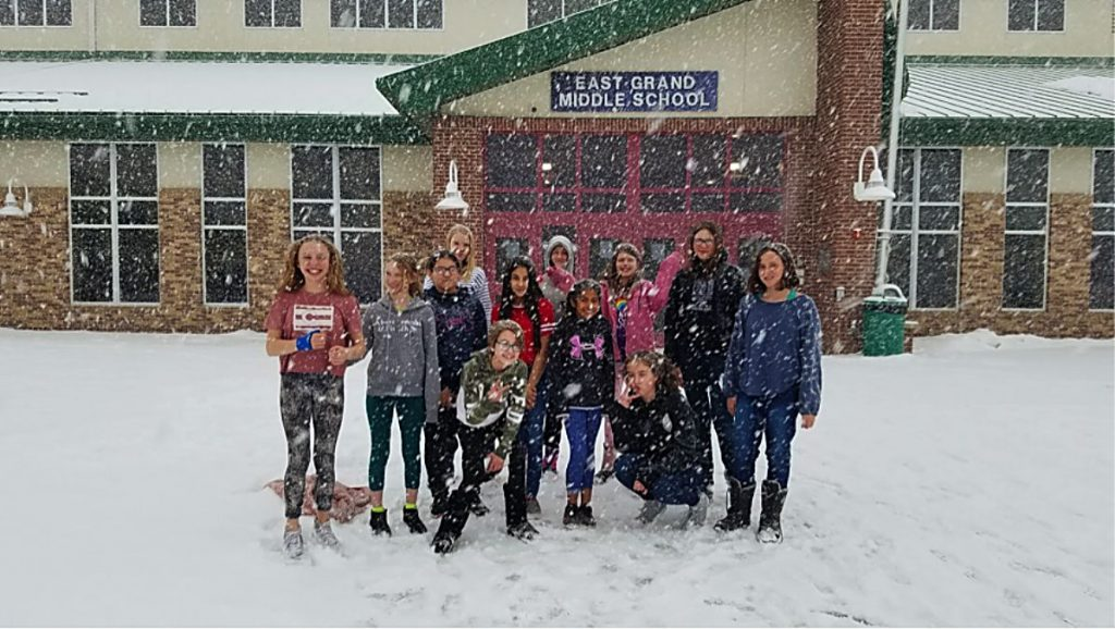 "Snow dumps on Drama Club while East Grand middle schoolers jump on ""The Orphan Train"" by Aurand Harris."
