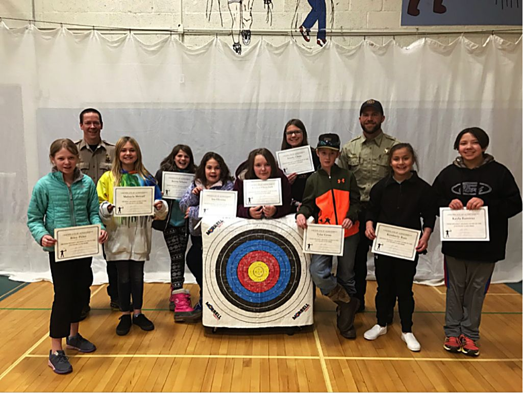 A group of the sharp shooters who received awards for the highest shooting scores in archery at GES pose for a photo.