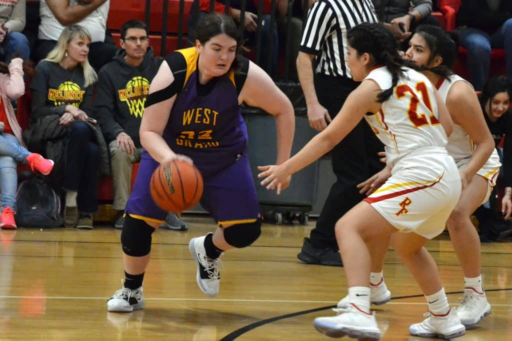 West Grand's Emma Daly (32) looks to dribble around Rocky Ford's Amber Saltzman (21) during Class 2A Region 8 Tournament semifinals action this past Friday, March 6, at event-hosting Ignacio High School. Seeded 24th in the State Championships' initial Round-of-32, the Lady Mustangs (13-11 overall) suffered a season-ending, 54-25 loss to the No. 9 Meloneers, despite Daly scoring a team-high seven points.