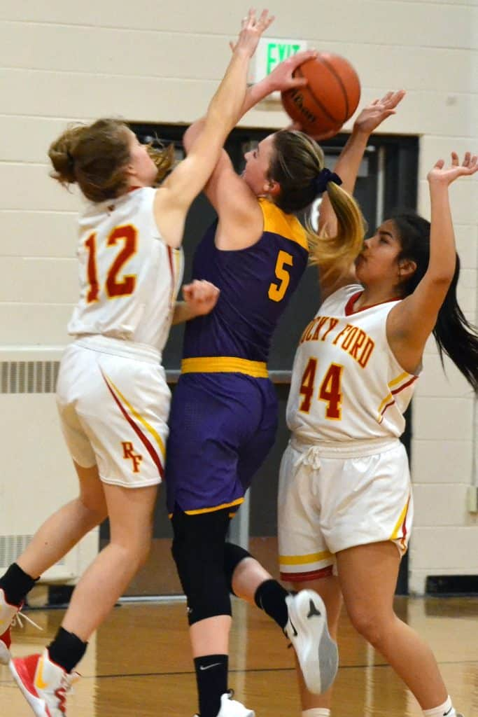 West Grand's Alex Schake (5) fights to put up a shot amidst aggressive defending by Rocky Ford's Lily Hancock (12) and Nevaeh Rodriguez (44) during Class 2A Region 8 Tournament semifinals action this past Friday, March 6, at event-hosting Ignacio High School. Seeded 24th in the State Championships' initial Round-of-32, the Lady Mustangs (13-11 overall) suffered a season-ending, 54-25 loss to the 9-seed Meloneers. Schake battled for six points in defeat, and was a rebounding presence RFHS struggled to out-perform.