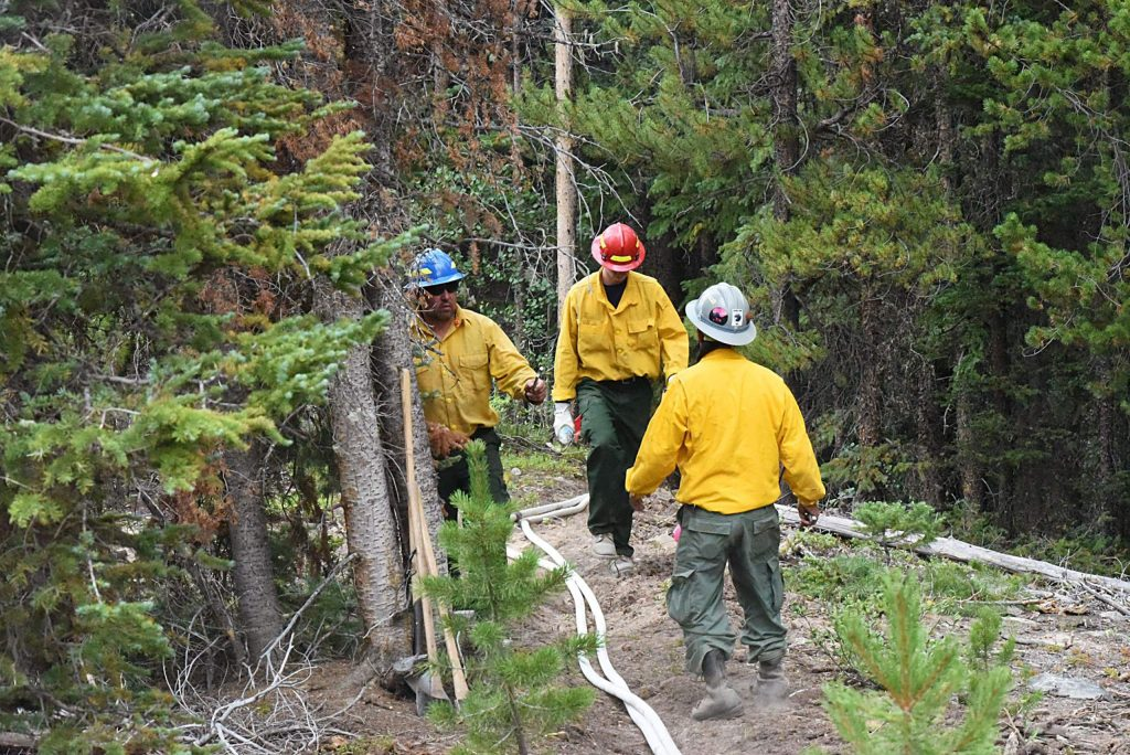 Fire crews have been working to dig ditches around the historic structures at the experimental forest headquarters, as well as removing fuels, trimming trees and setting up an extensive sprinkler system.