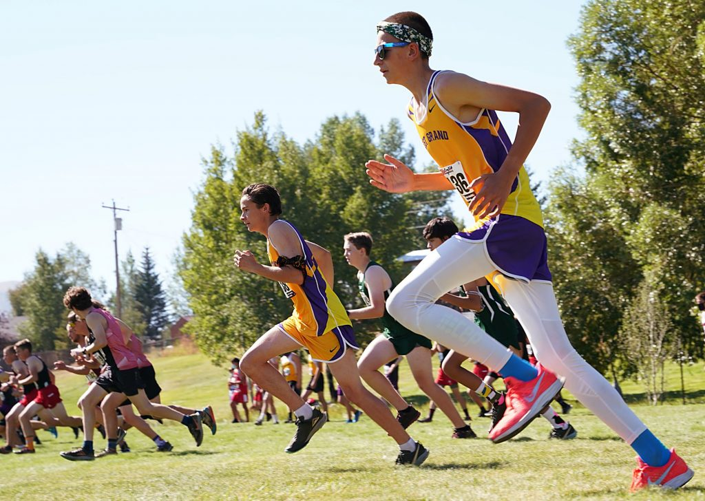West Grand's Galen Wilkinson, left, and Henry Westfahl, right, take off at the start of the boys race Saturday at the West Grand Invitational. Wilkinson finished 14th and Westfahl was 15th.