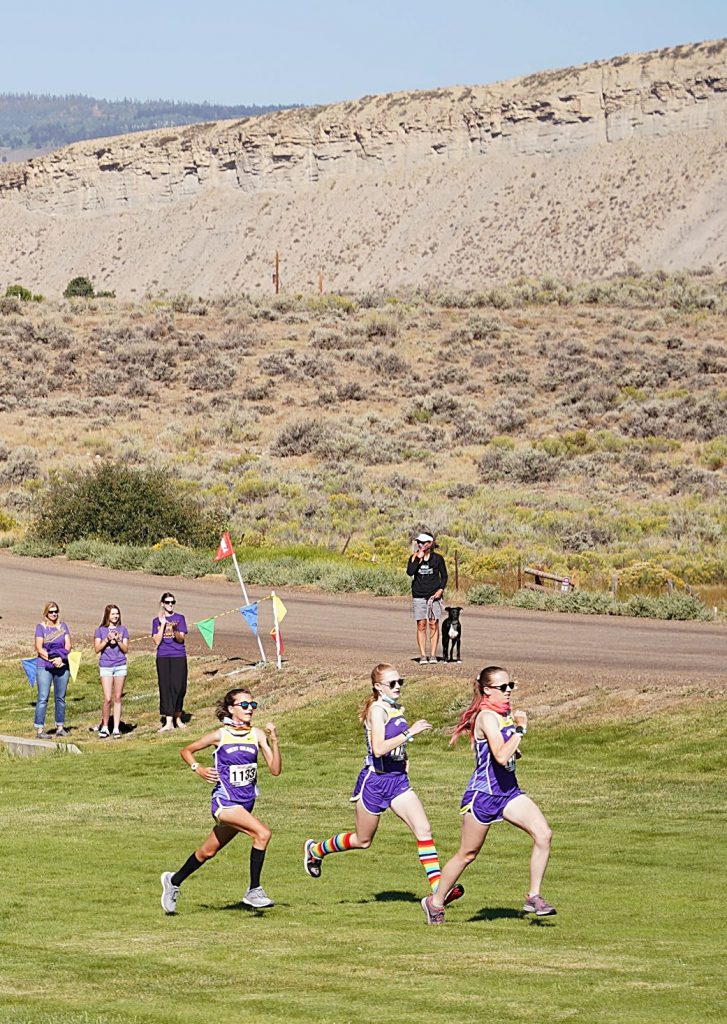 From left, Allura Luna, Joy Hast and Samantha Westfahl take off in the first wave of runners Saturday at the West Grand Invitational in Kremmling. Westfahl had the best finish among Grand County competitors and took fourth in the race.