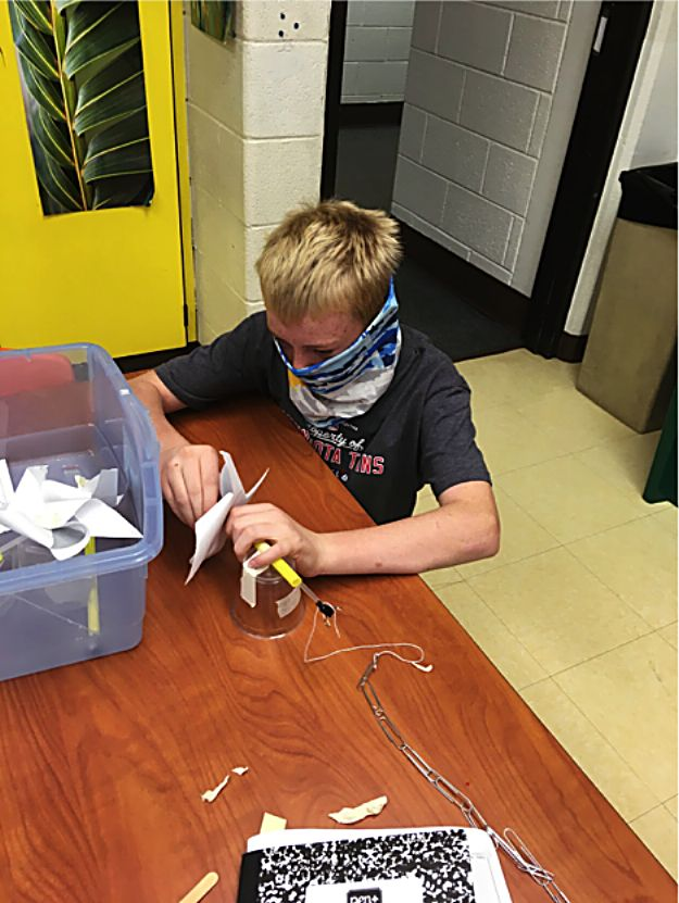 In science class, Granby Elementary students are learning about renewable energy by making windmills that can lift paperclips.