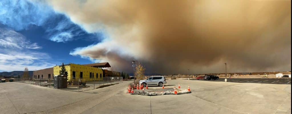 Smoke rises from the East Troublesome Fire near Middle Park Health's Granby Campus on Friday.
