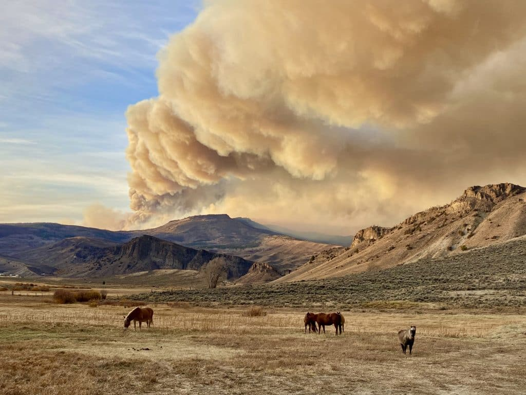 The East Troublesome Fire is seen behind elk mountain.