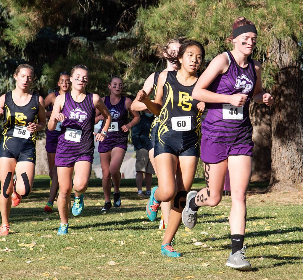 Middle Park's Katie Trail, Maddy Trail, Leah Cormican and Sierra Manyak run at the regional cross country meet Saturday in Durango. Katie Trail placed 16th, followed by Manyak  in 19th, Maddy Traill at 22nd and Cormican in 24th.