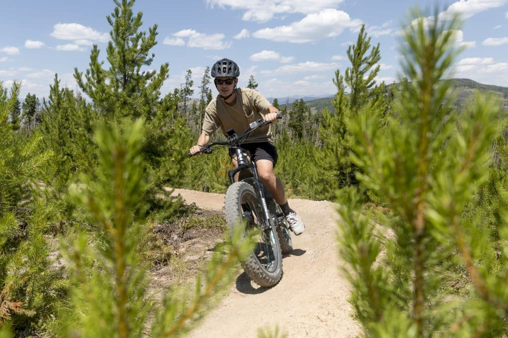 Explore the ranch by bike on miles of dirt trails and paved pathways. (Photo courtesy of Snow Mountain Ranch)